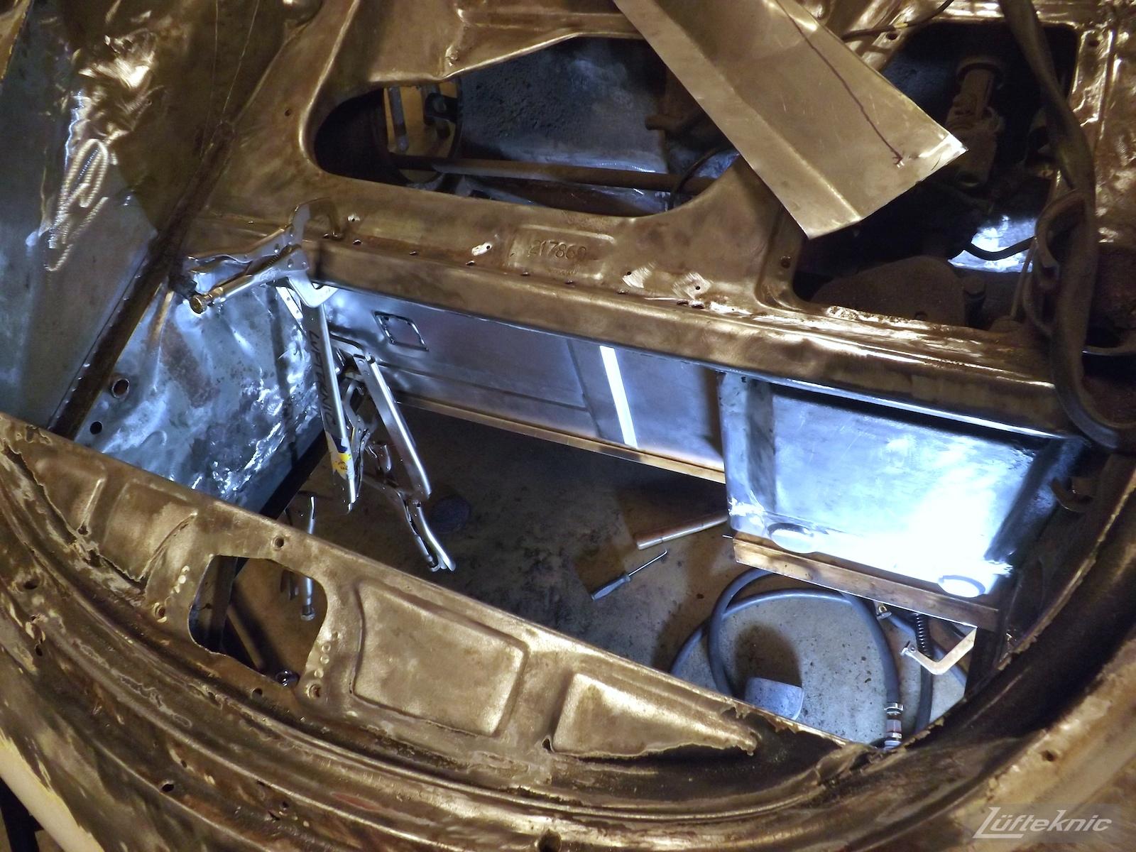 Metal work on a White 1964 Porsche 356SC being restored.