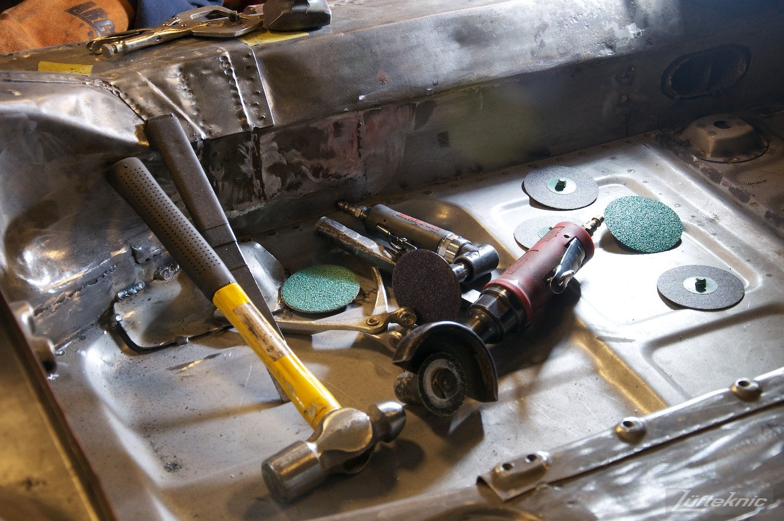 Body working tools on the floor of a Porsche 356