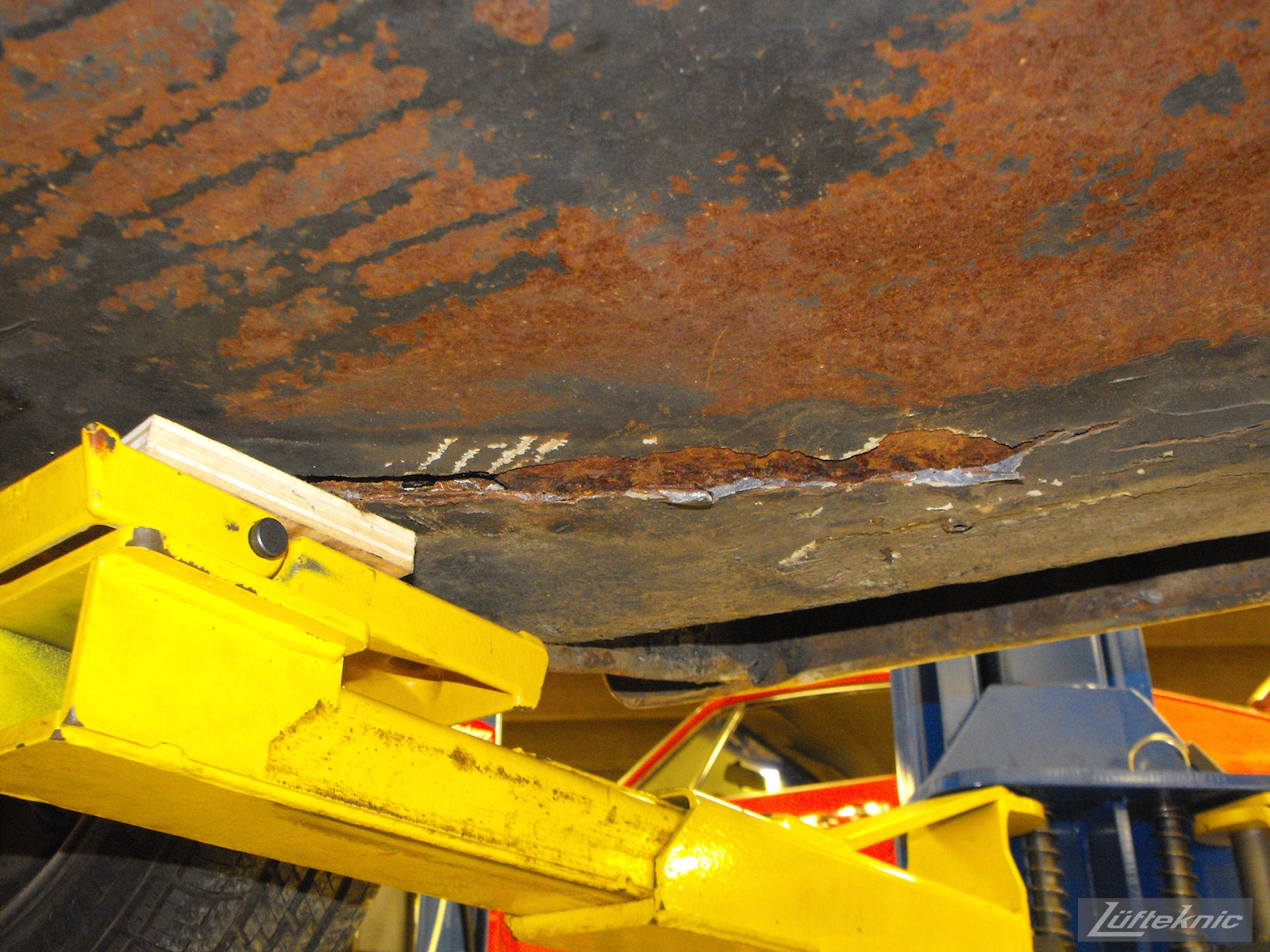 Rusty floors on a 1964 Porsche 356SC restoration.