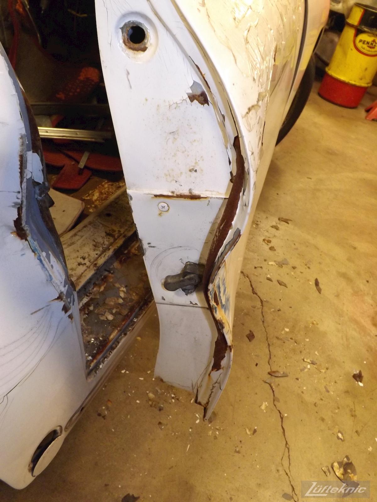 Door crash damage on a1964 Porsche 356SC restoration.