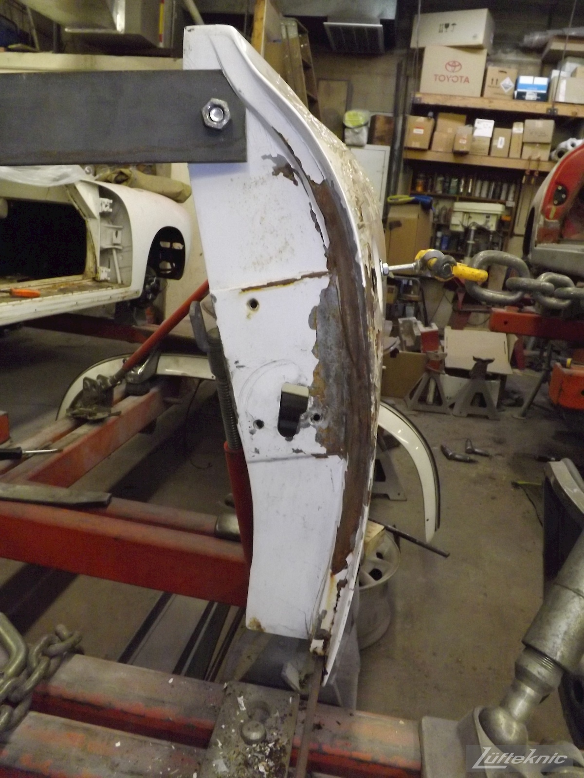 Door repair on a 1964 Porsche 356SC restoration.