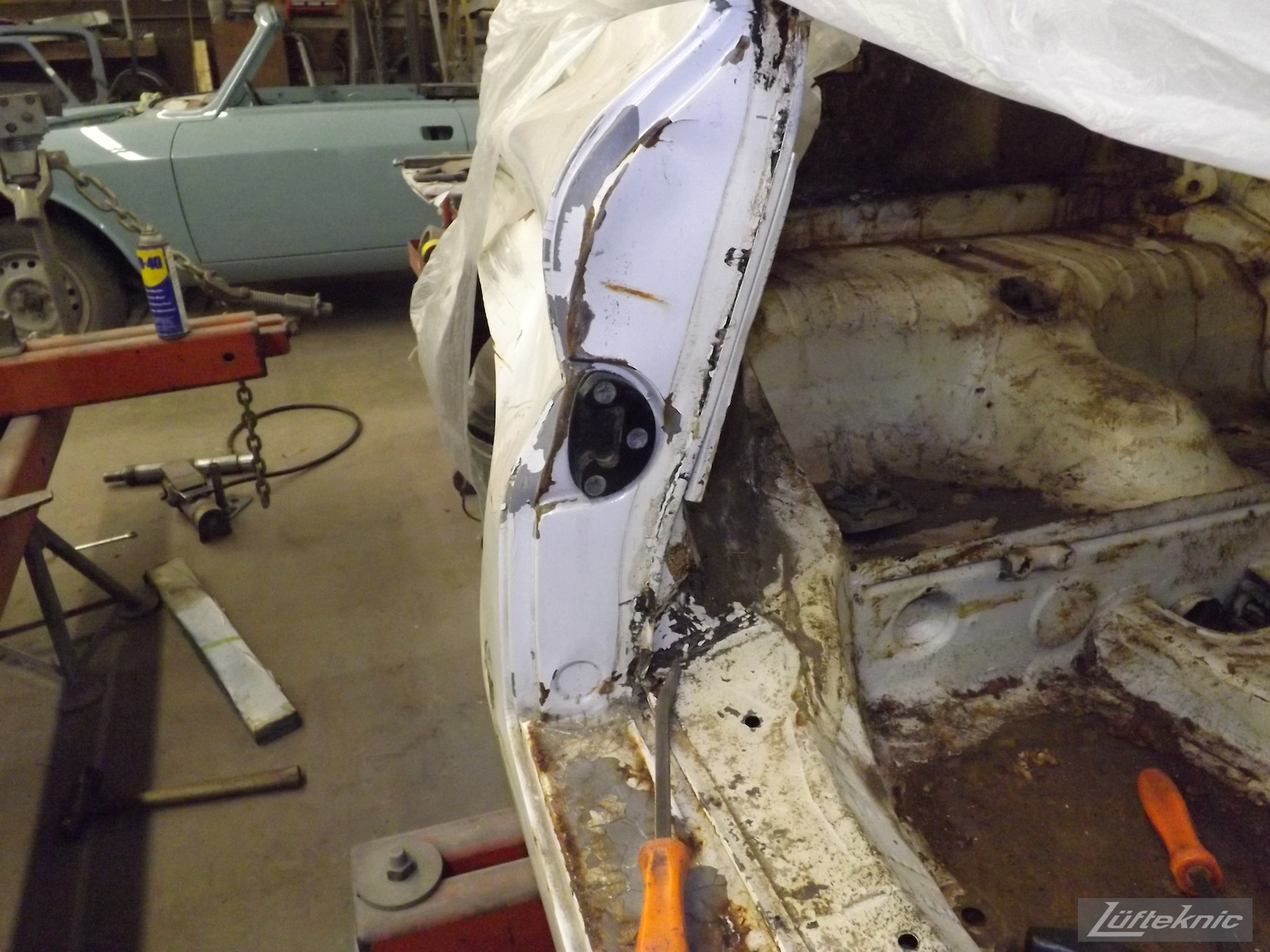 Crash damage on a 1964 Porsche 356SC restoration.