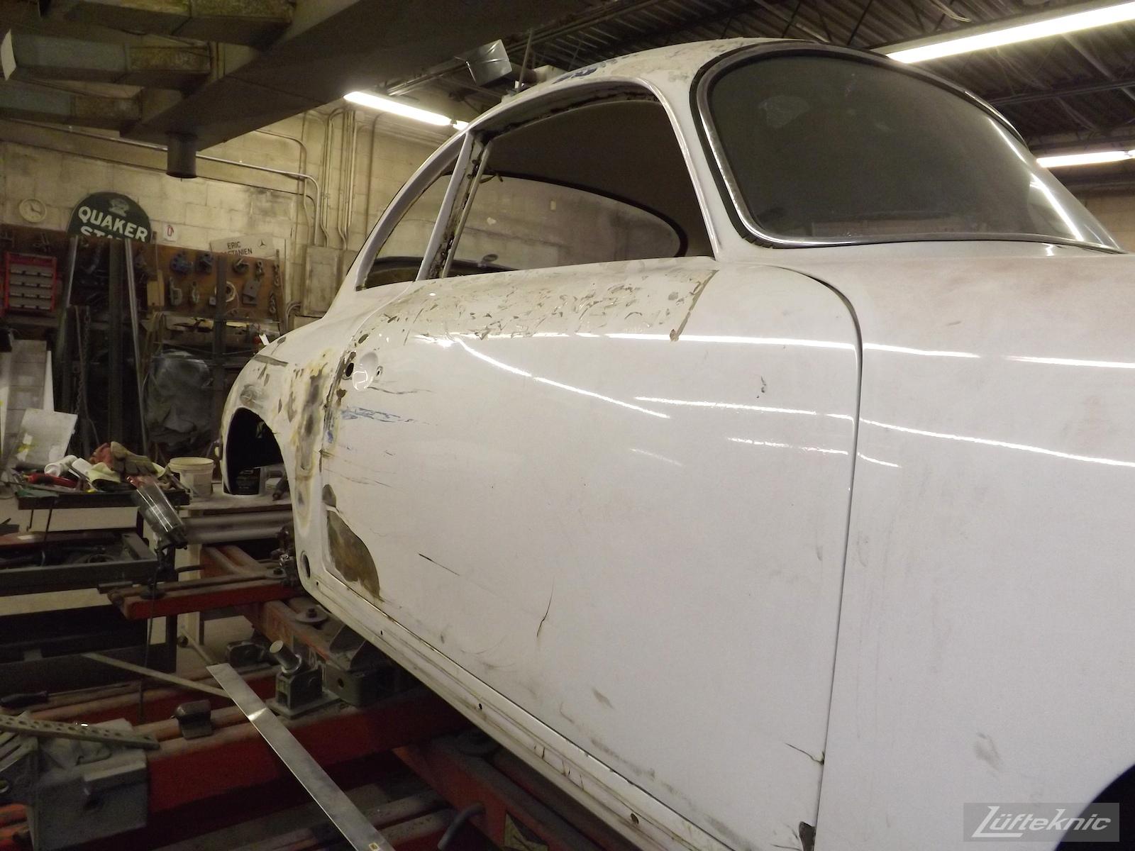 Chassis straightening on a 1964 Porsche 356SC restoration.