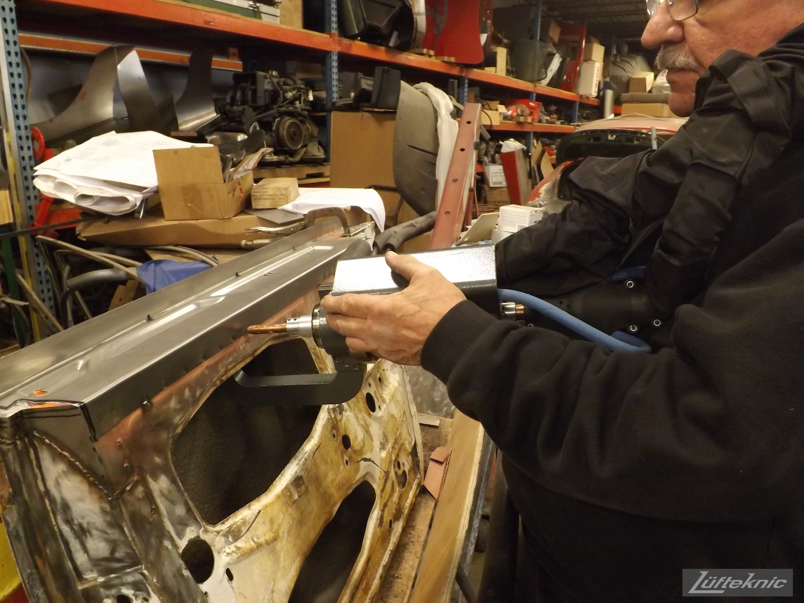 spot welding a door repair for a 1964 Porsche 356SC restoration.