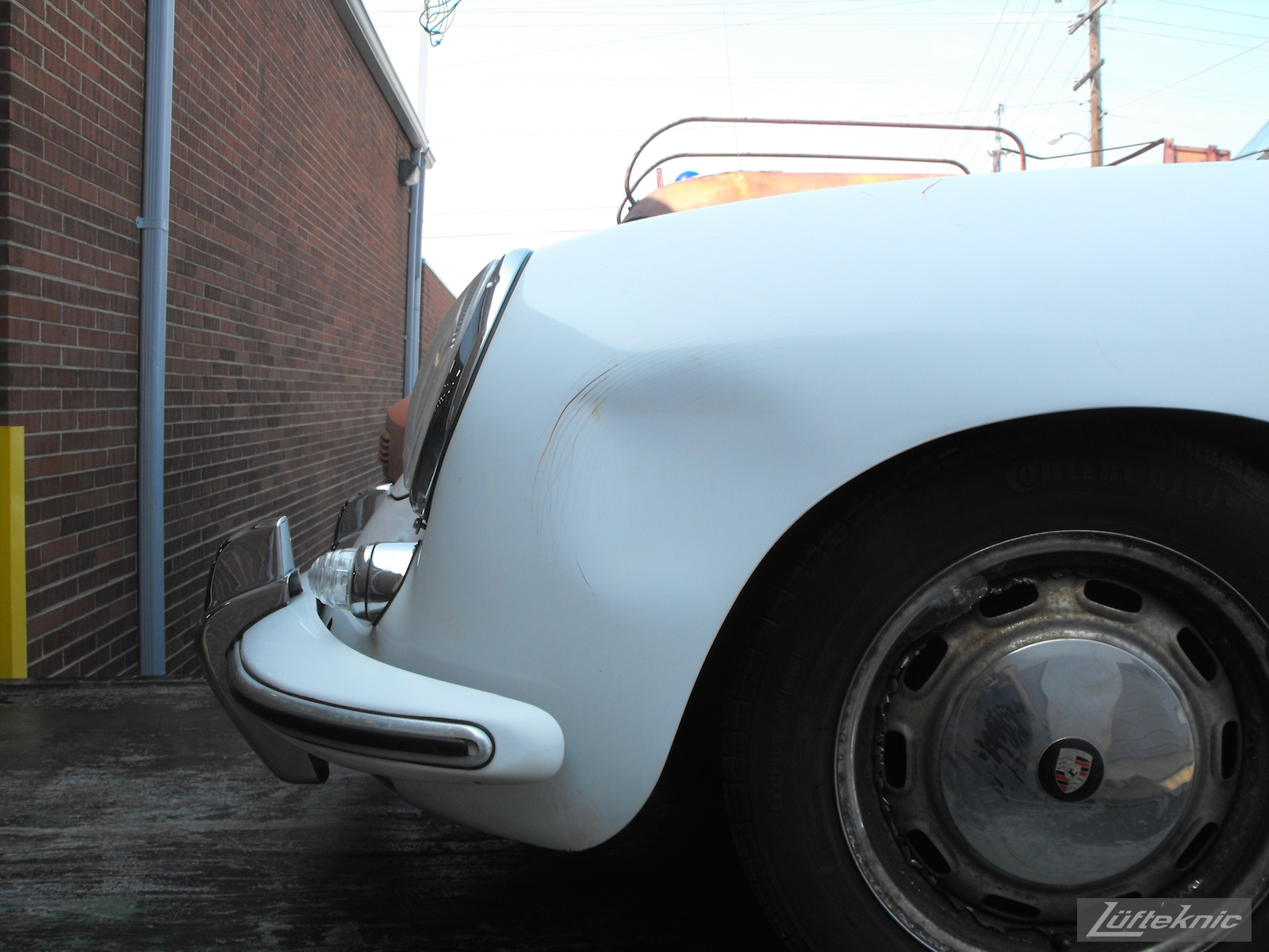 Dented fender pre 1964 Porsche 356SC restoration.