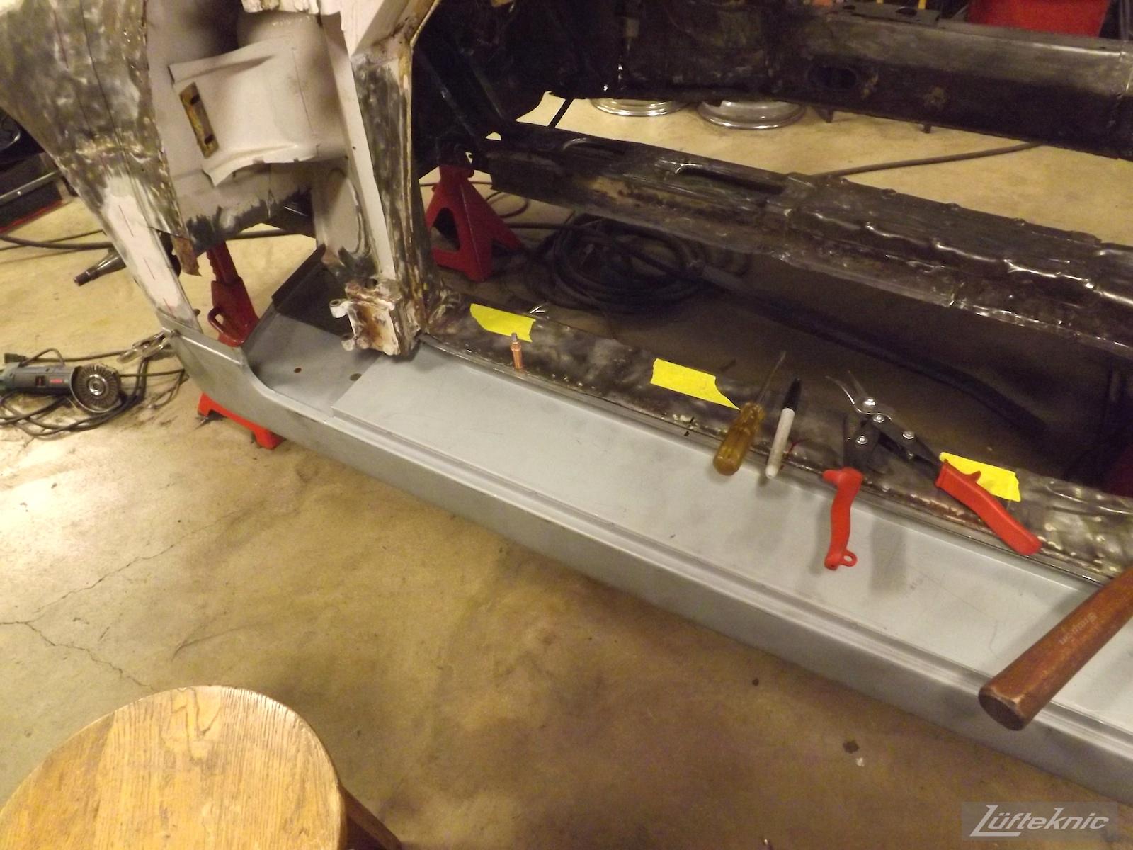 Rocker repair on a White 1964 Porsche 356SC restoration.
