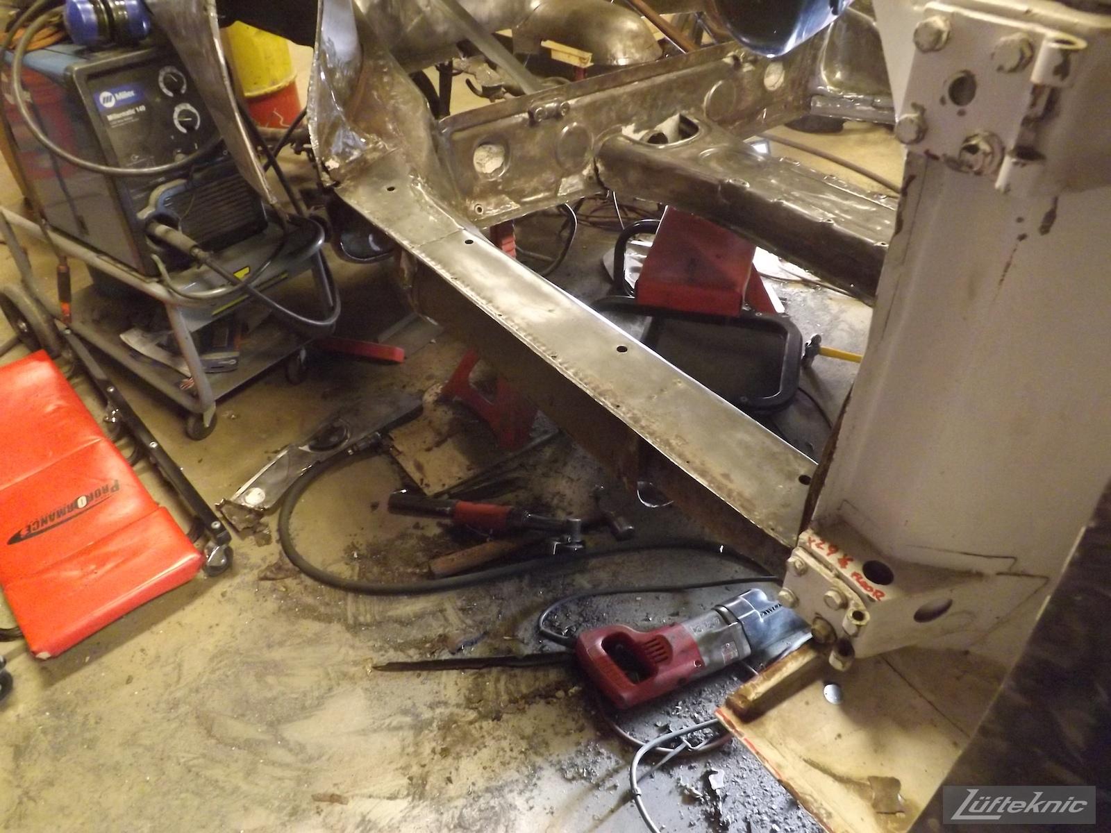 Chassis repair on a white 1964 Porsche 356SC restoration.