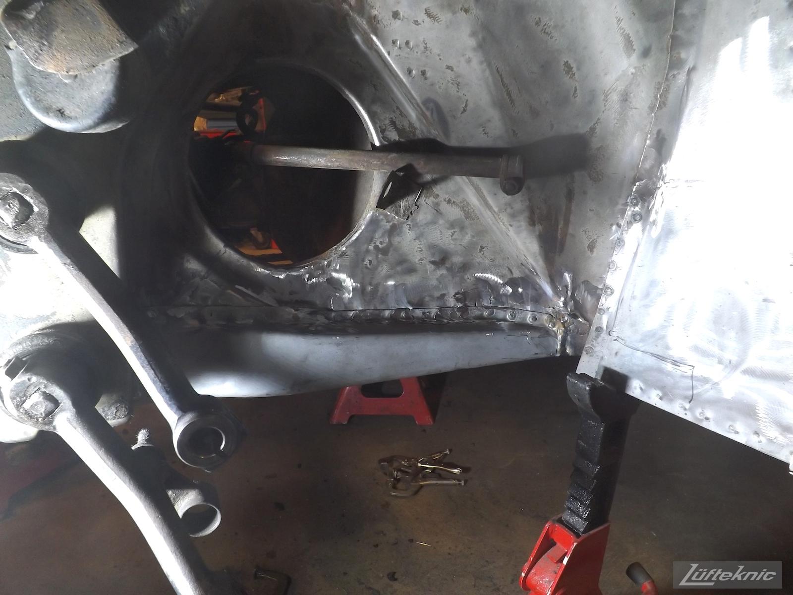Frame repair on a White 1964 Porsche 356SC being restored.