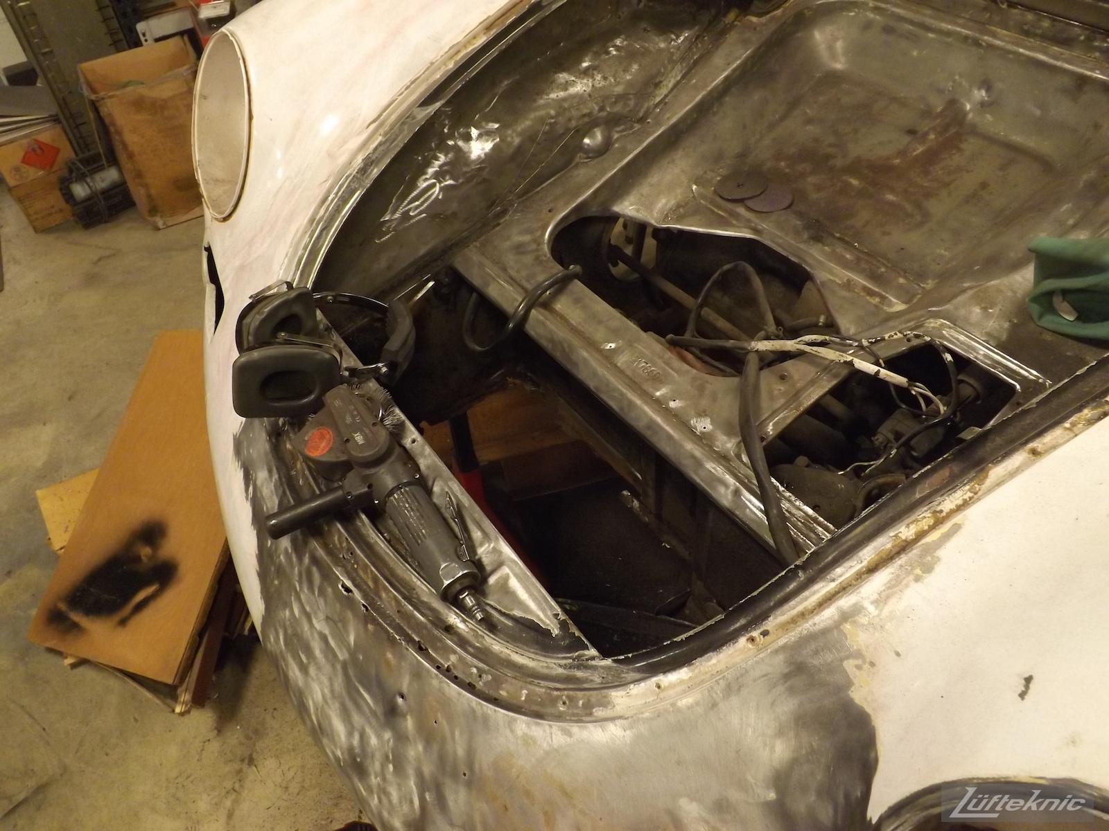 Front floor repair on a White 1964 Porsche 356SC being restored.