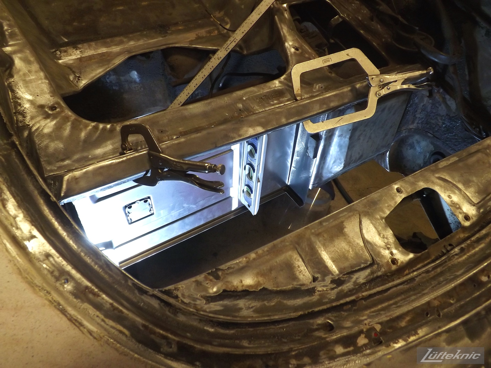 Metal work and repair on a White 1964 Porsche 356SC being restored.