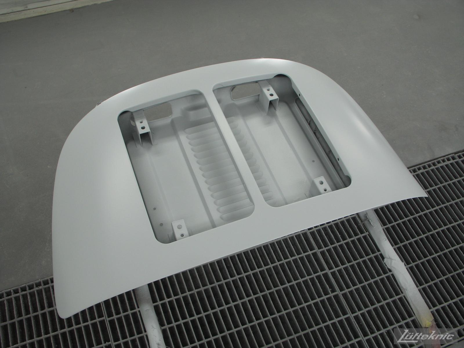 Primered engine cover for White 1964 Porsche 356SC restoration