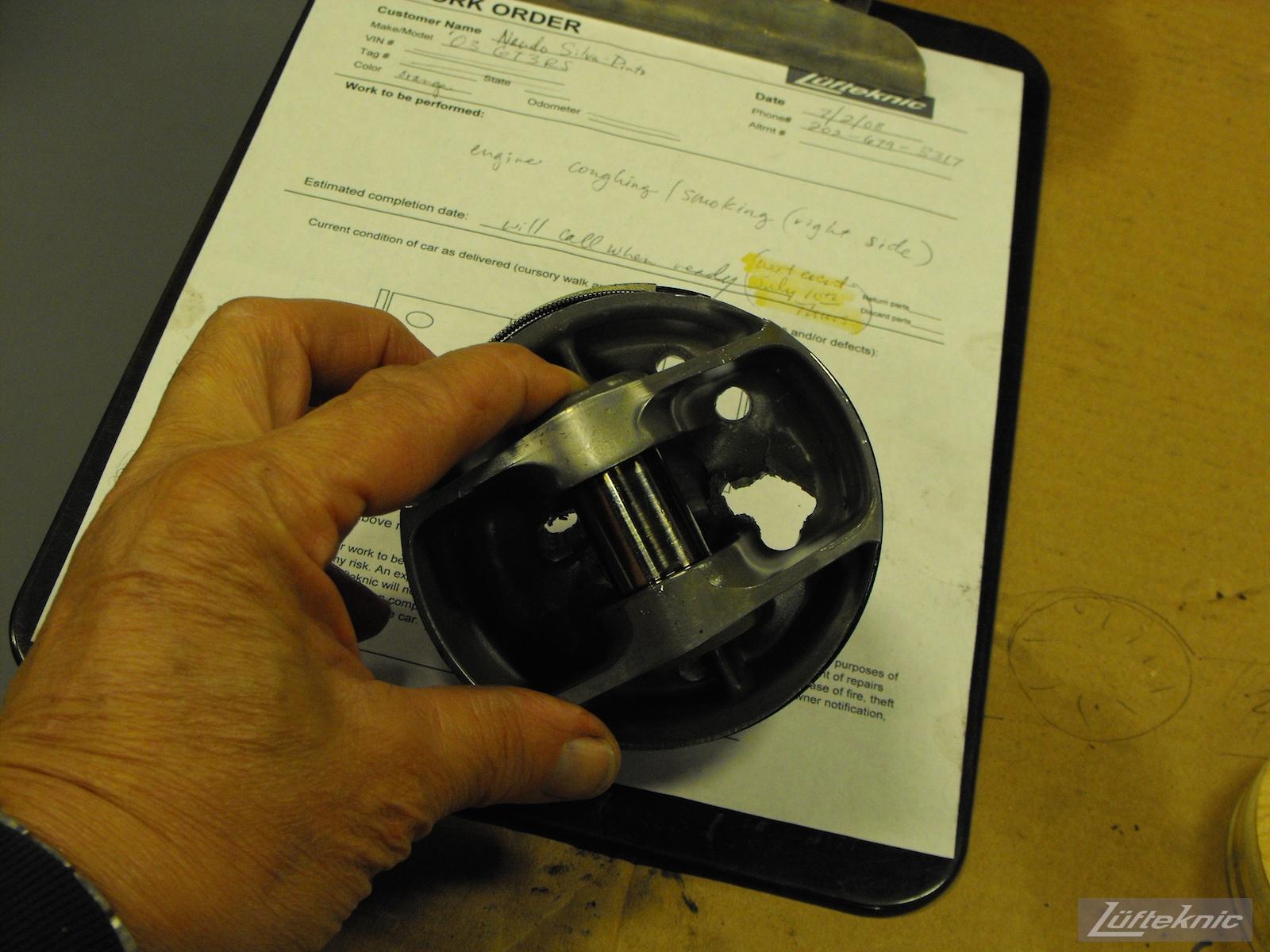 ZIP Racing Hazardous Sports Porsche 996 GT3 RS damaged piston
