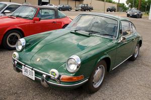 Irish Green Porsche 912 in a parking space.