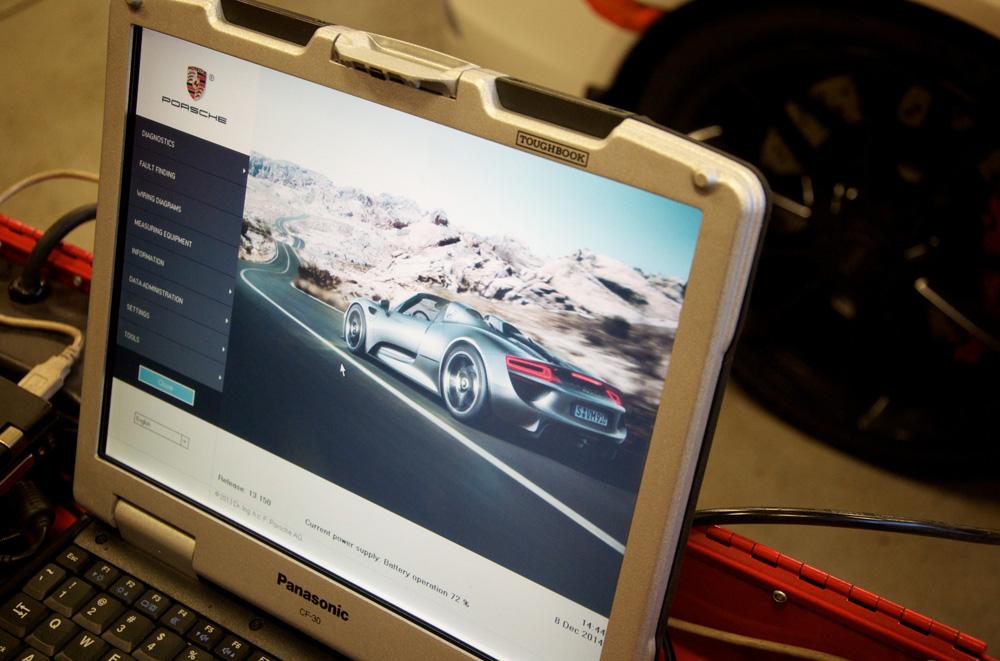 A close up image showing a screen shot of a Porsche PIWIS computer.