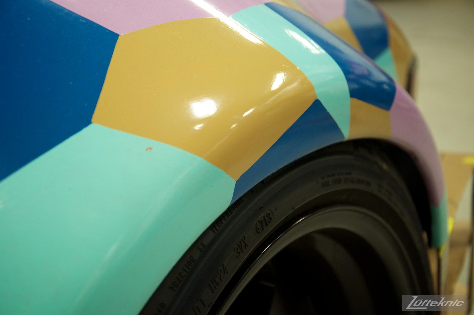 Hand painted details on 930 Porsche.