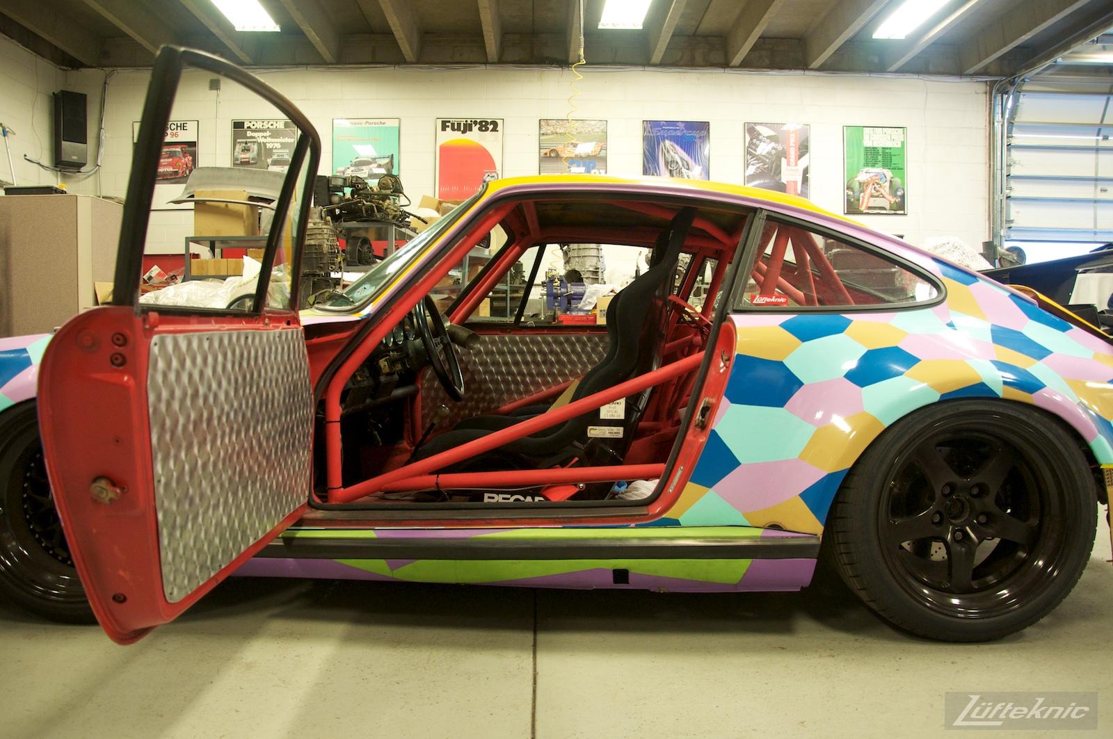 A wide open door on the Lüfteknic #projectstuka Porsche 930 Turbo inside the Lüfteknic shop