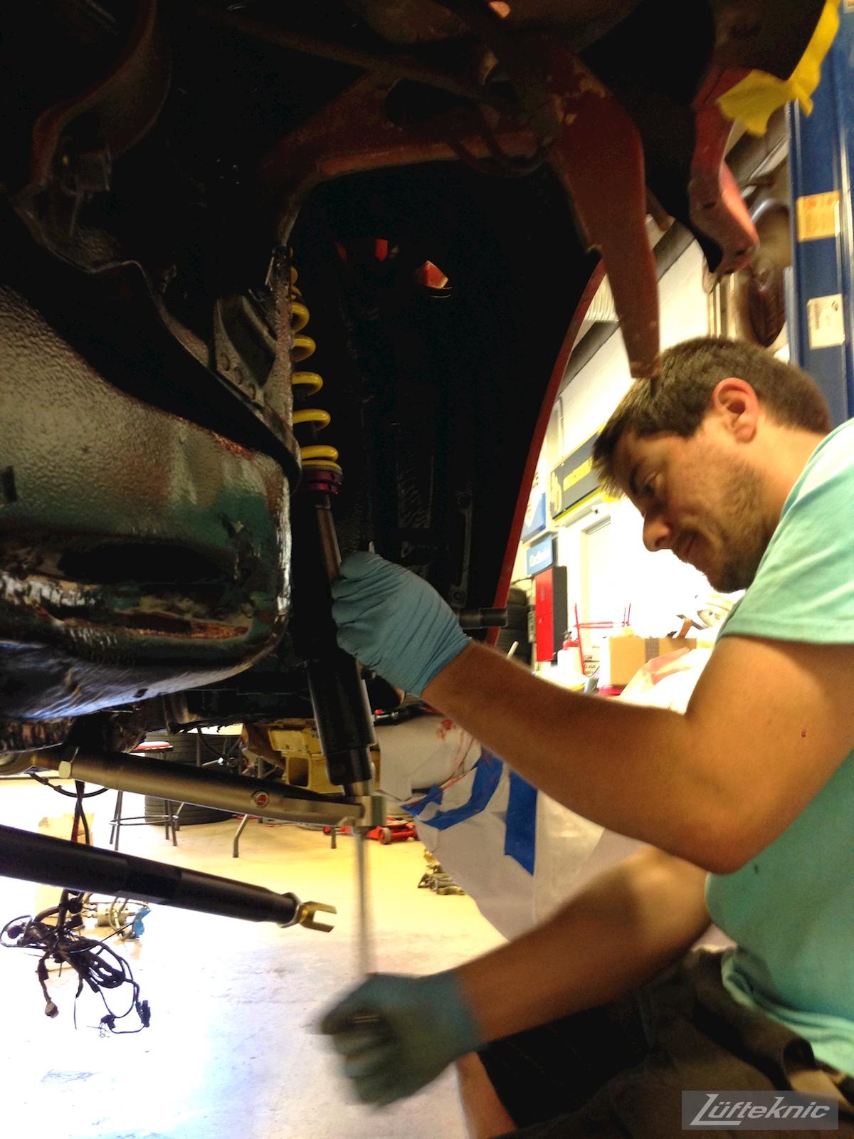 A Lüfteknic employee works on the #projectstuka Porsche 930 Turbo suspension