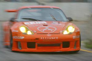 A blurred picture of the Hazardous Sports Porsche GT3 Rs in orange