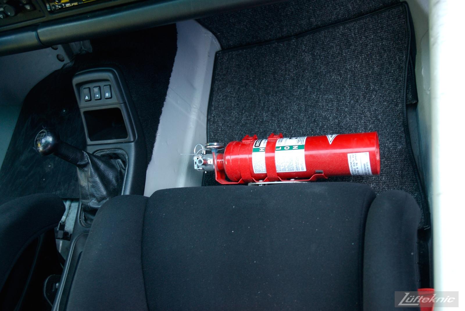 Track prepped Porsche 964 RS America fire extinguisher.