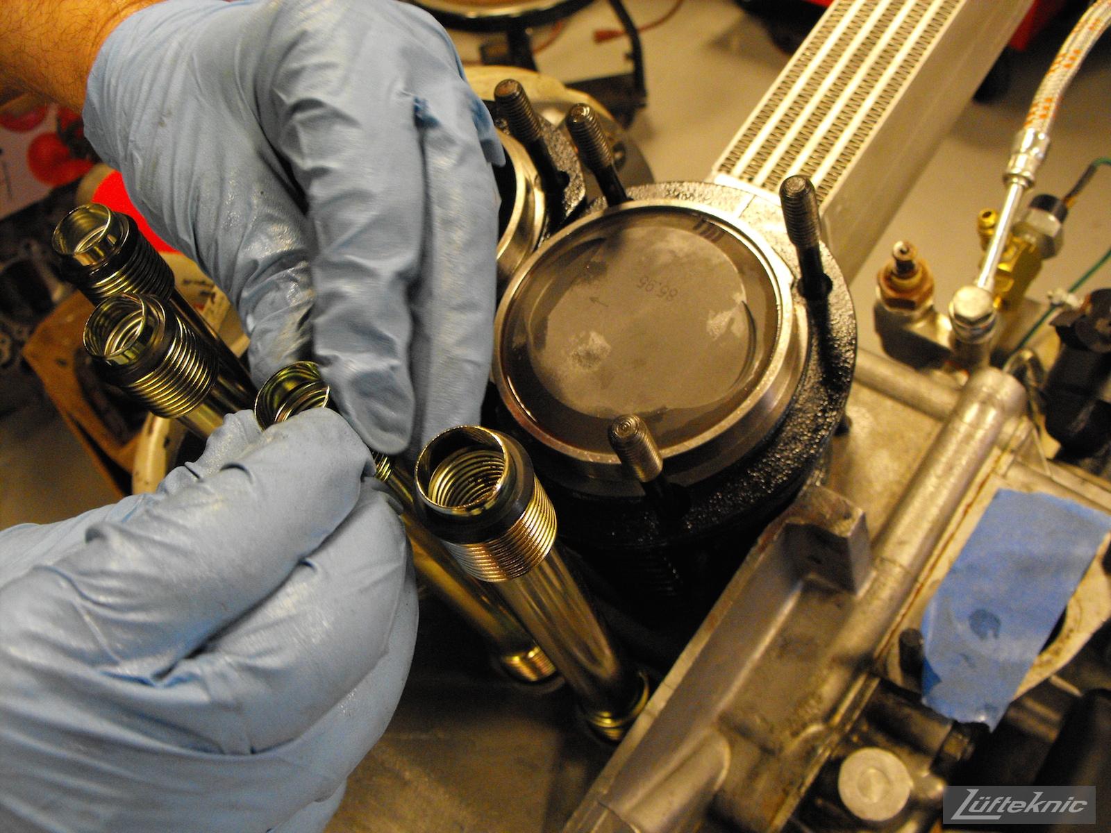 Installing oil return tubes for a 1961 Porsche 356B Roadster restoration.