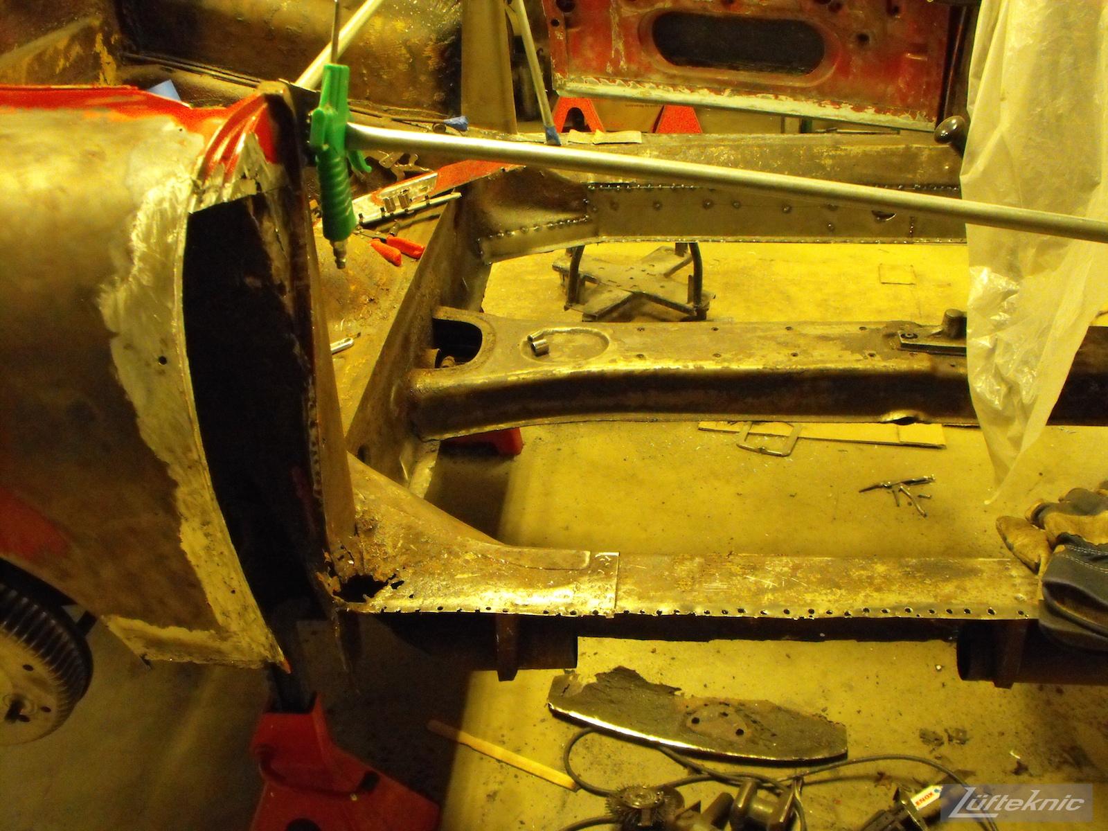 Deep into rust repair on a 1961 Porsche 356B Roadster restoration.