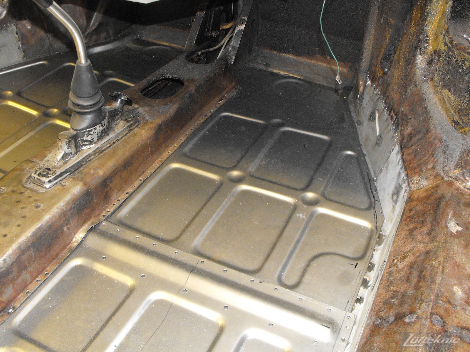 New floors being installed into a 1961 Porsche 356B Roadster restoration.