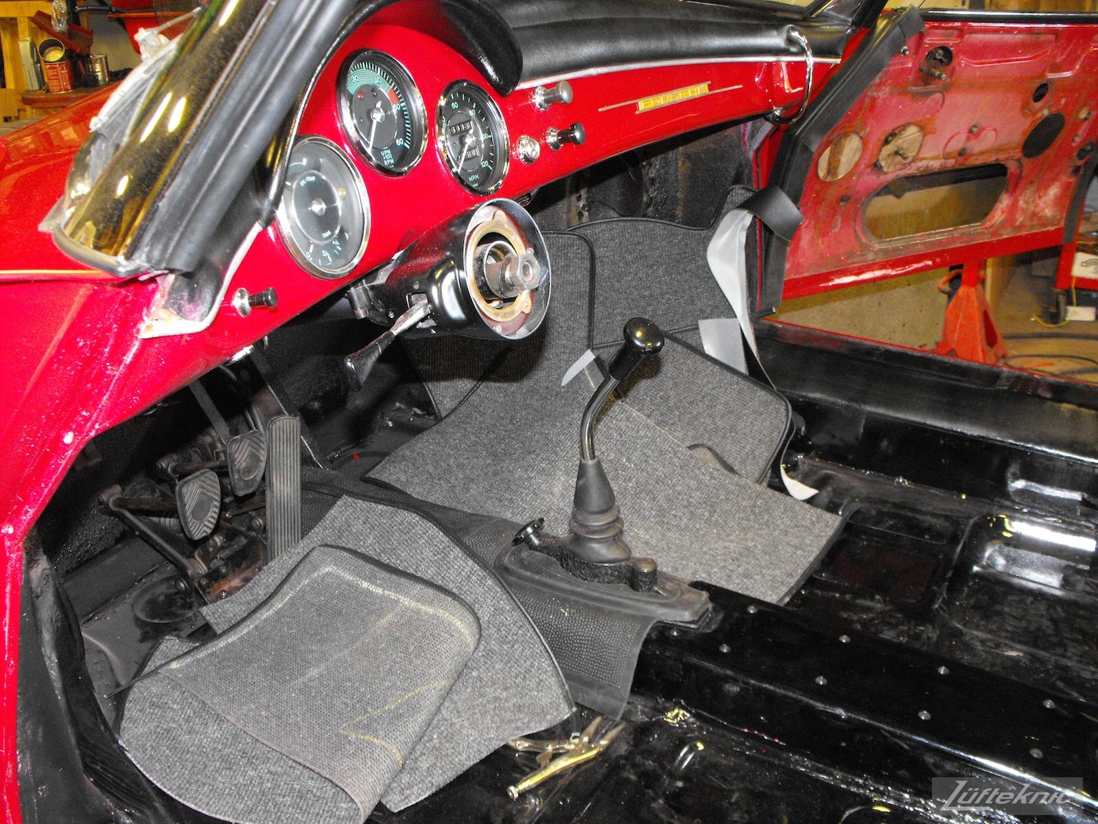 Interior reassembly on a 1961 Porsche 356B Roadster restoration.