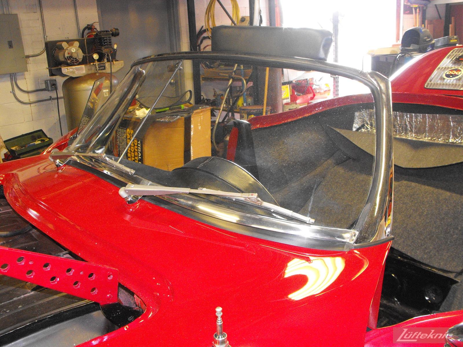 Windshield installed on a 1961 Porsche 356B Roadster restoration.