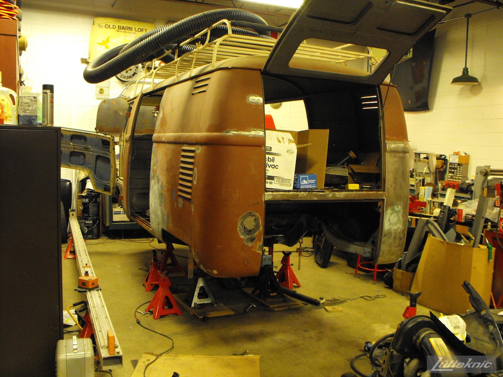 1956 Volkswagen double panel Transporter Porsche Bus trial fit of 3.2 Carrera engine.