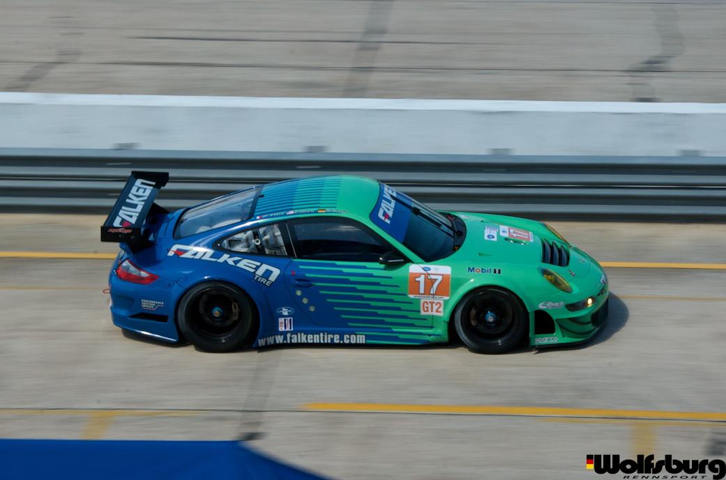 The iconic teal and blue Falken Tire Porsche 911 RSR at Sebring raceway.