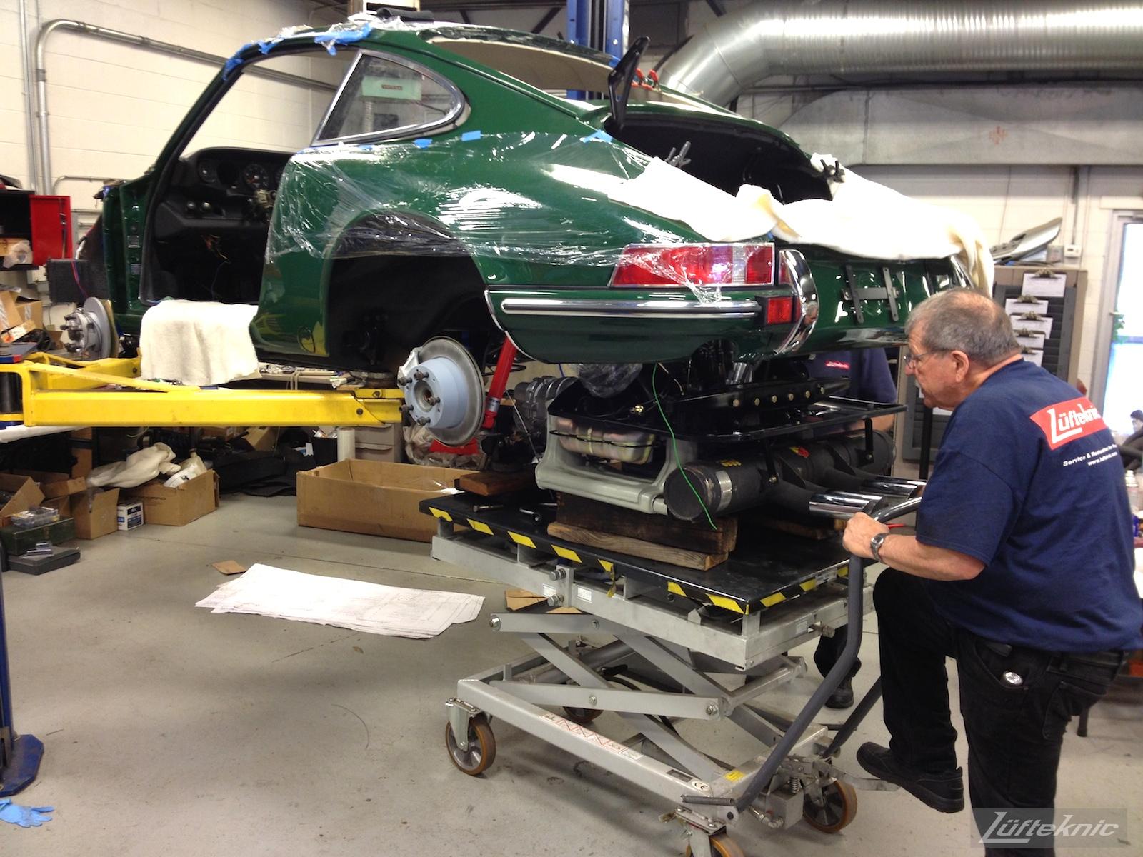 Porsche 912 engine being installed