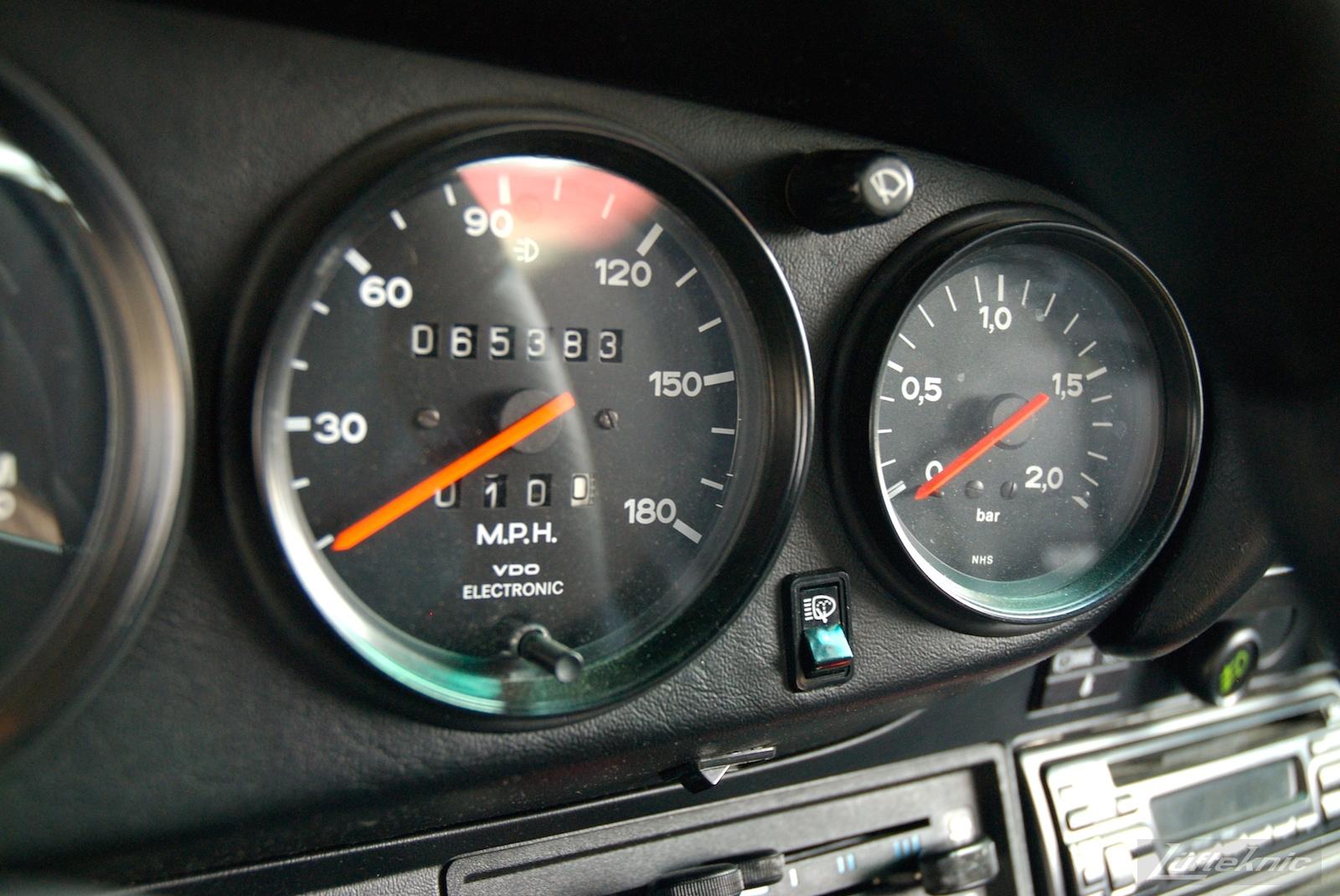 Red Porsche 930 Turbo gauges.