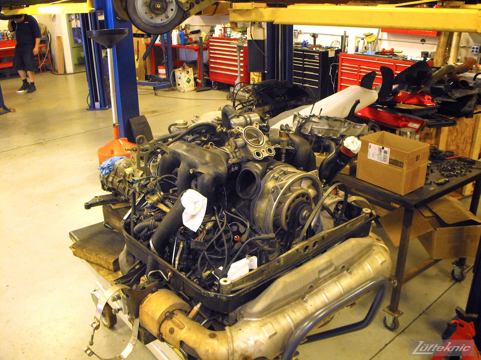 A Porsche 993TT engine on the engine table at Lufteknic.