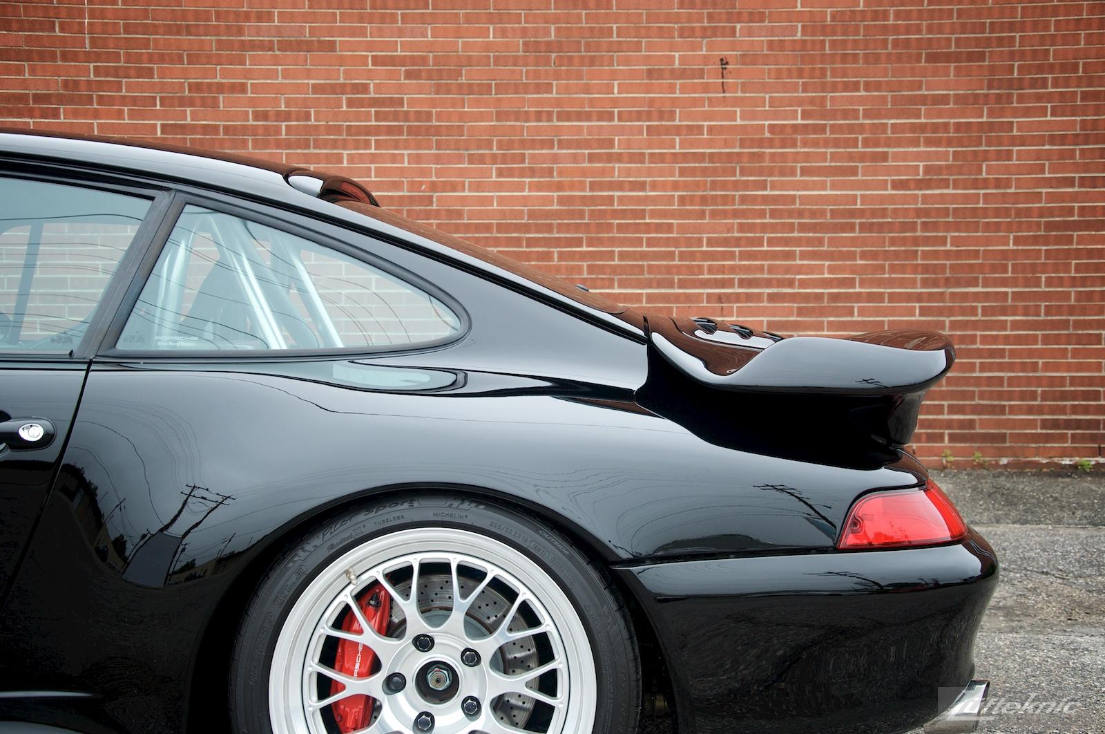 A black 993 Porsche Turbo GT2 conversion sits in the Lufteknic parking lot.