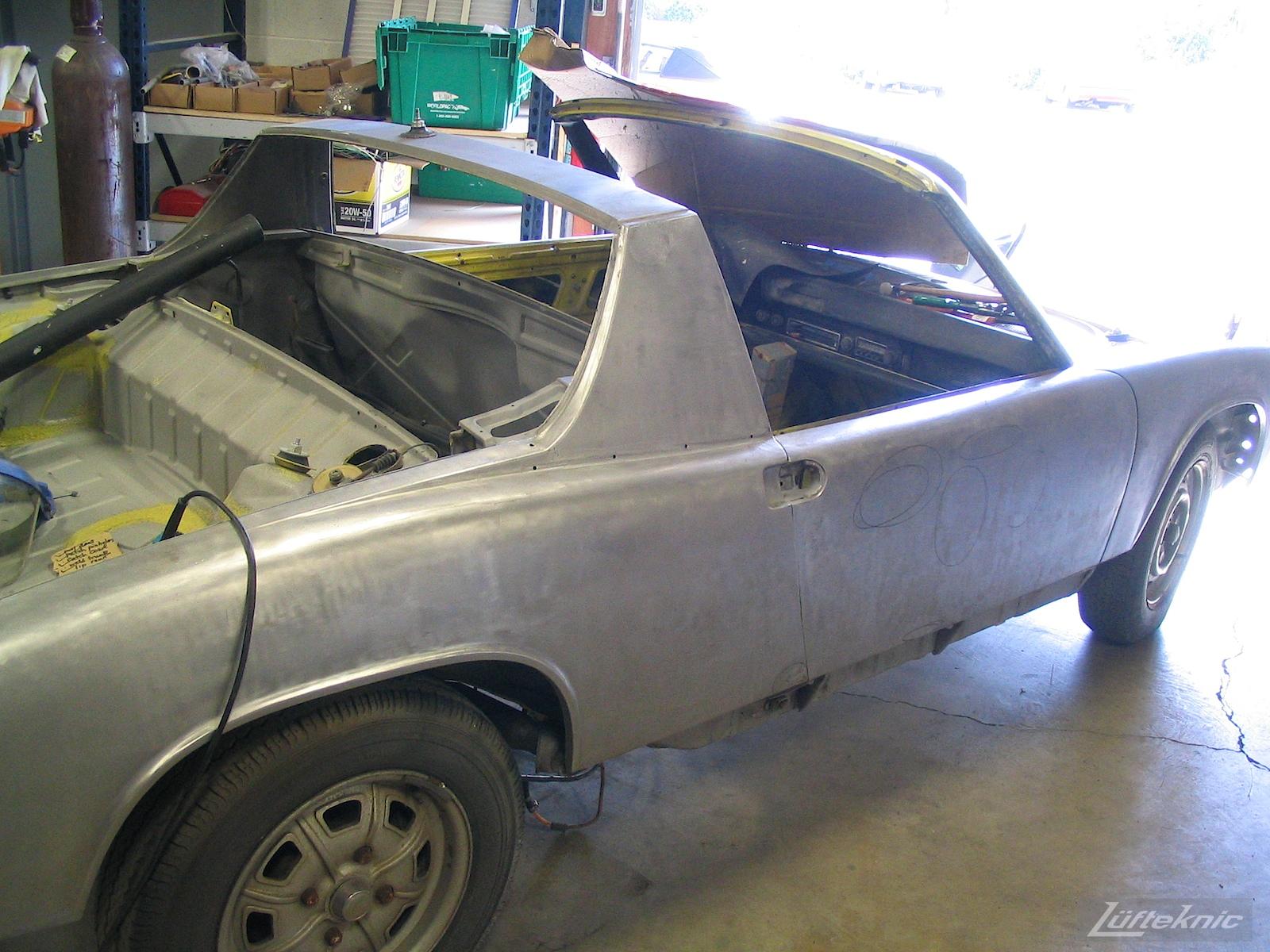 Bare metal sanded Porsche 914 undergoing restoration.