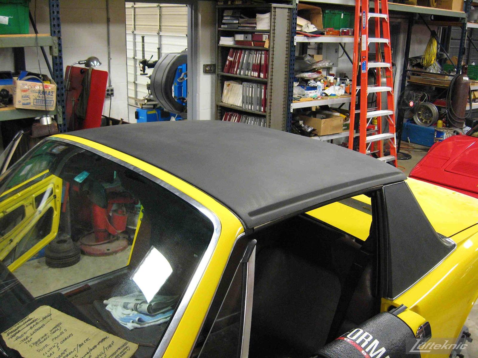 New top on a restored yellow Porsche 914 at Lufteknic.