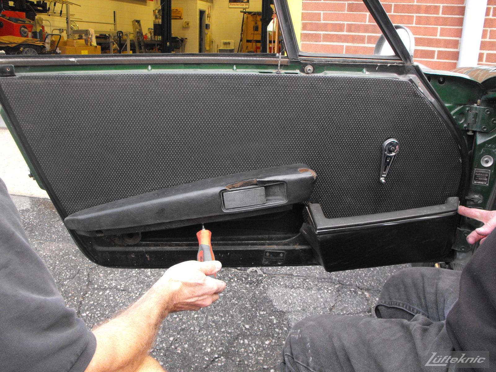 An Irish Green Porsche 912 undergoing restoration at Lufteknic. Removing the door panel.