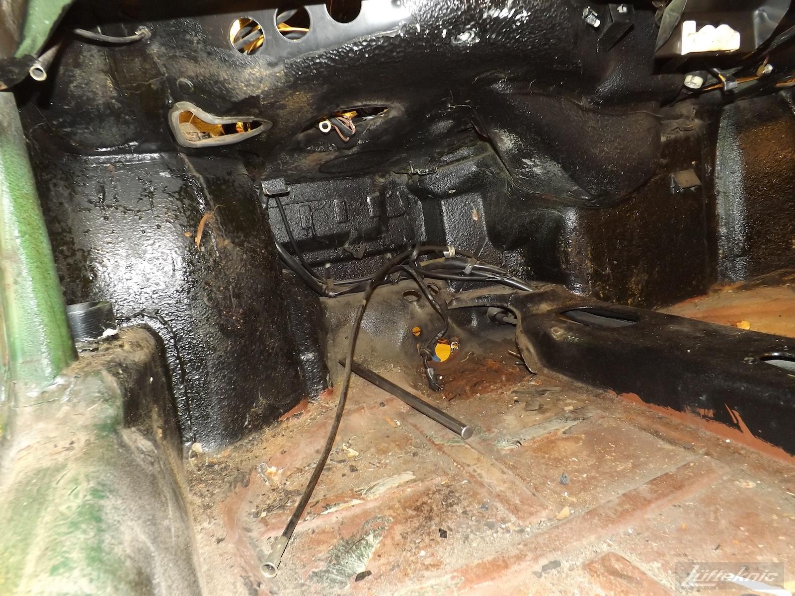 Floor boards and pedal box area on an Irish Green Porsche 912 undergoing restoration at Lufteknic.