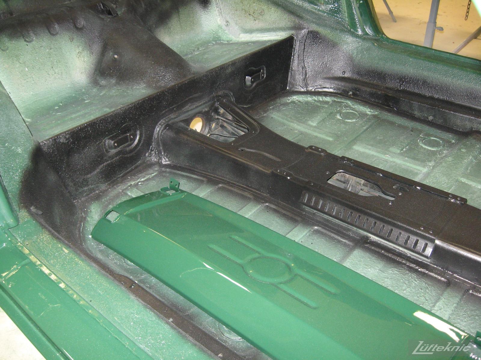 Body panel and floors of an Irish Green Porsche 912 undergoing restoration at Lufteknic.