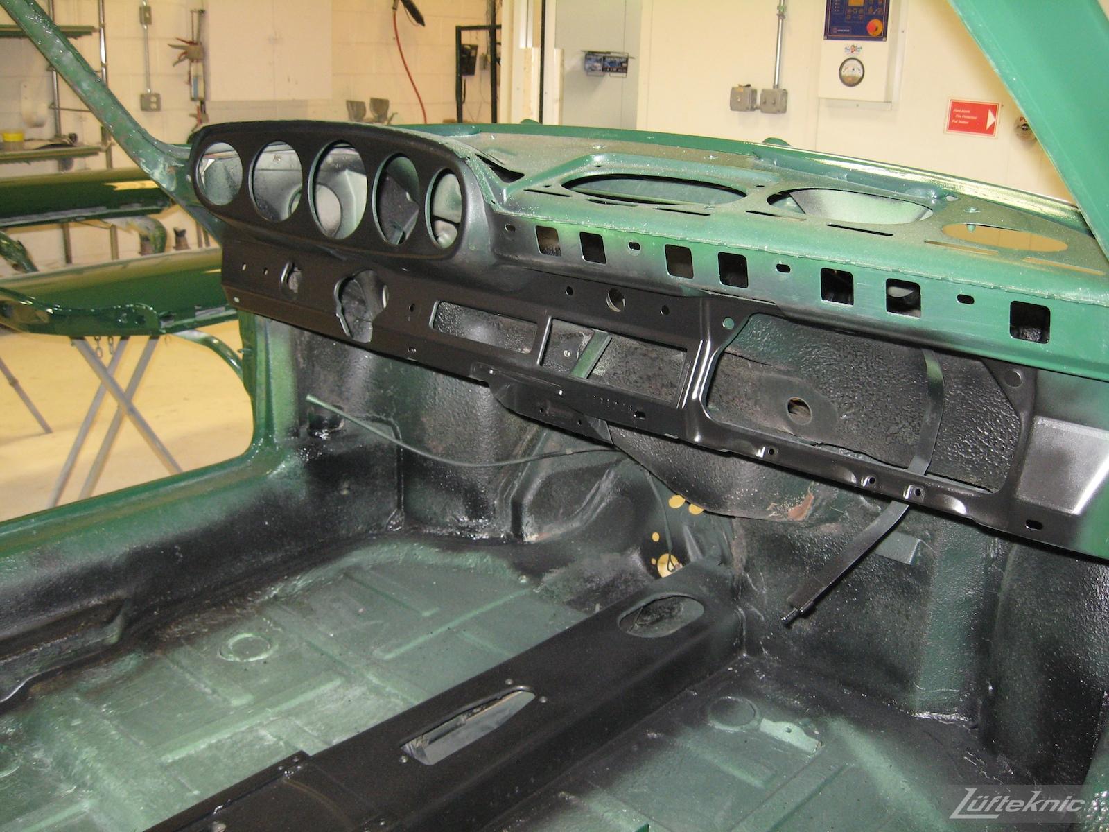 Fresh dash paint and coated floors on an Irish Green Porsche 912 undergoing restoration at Lufteknic.