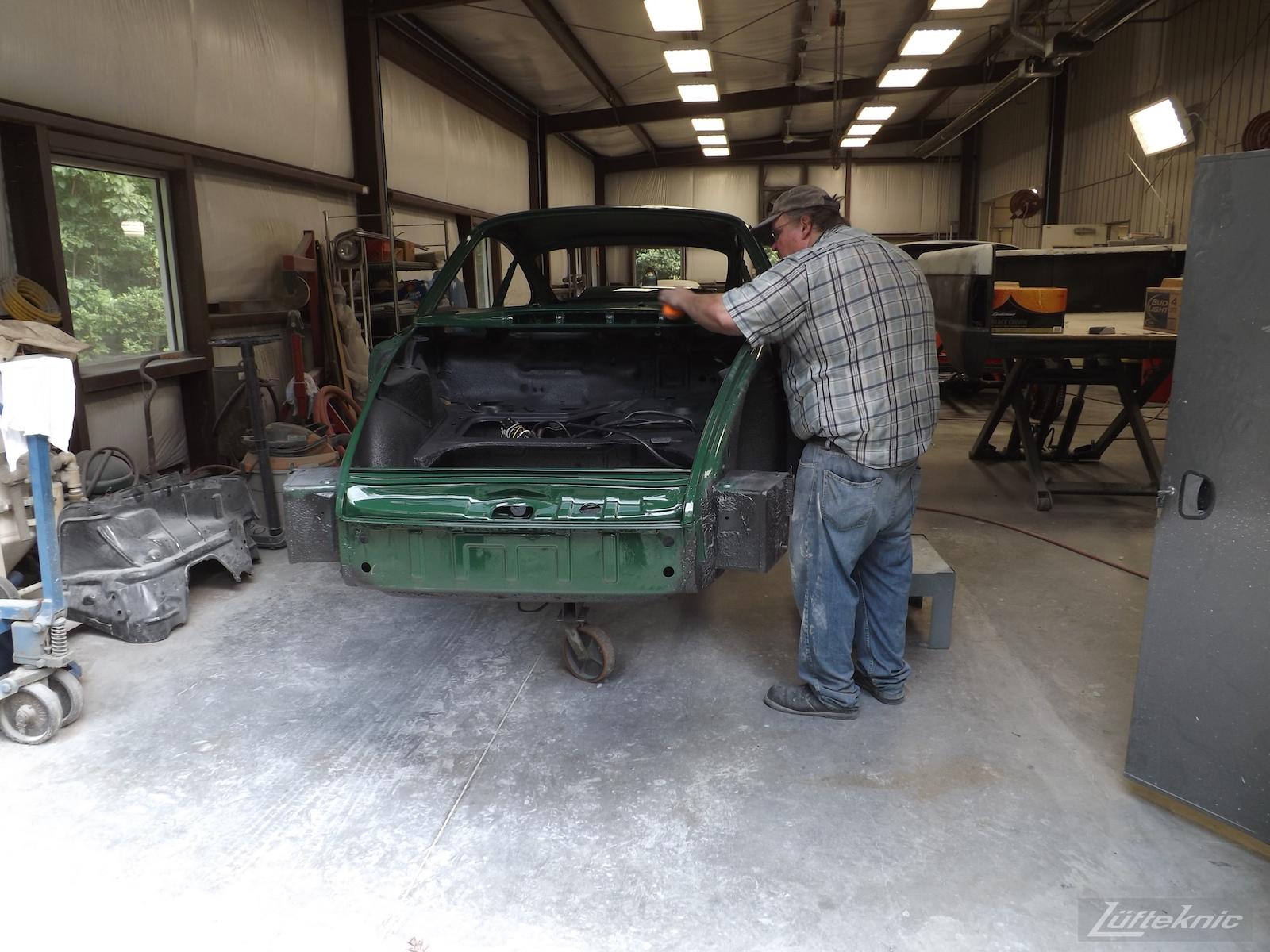 Final touches on the body of an Irish Green Porsche 912 undergoing restoration at Lufteknic.