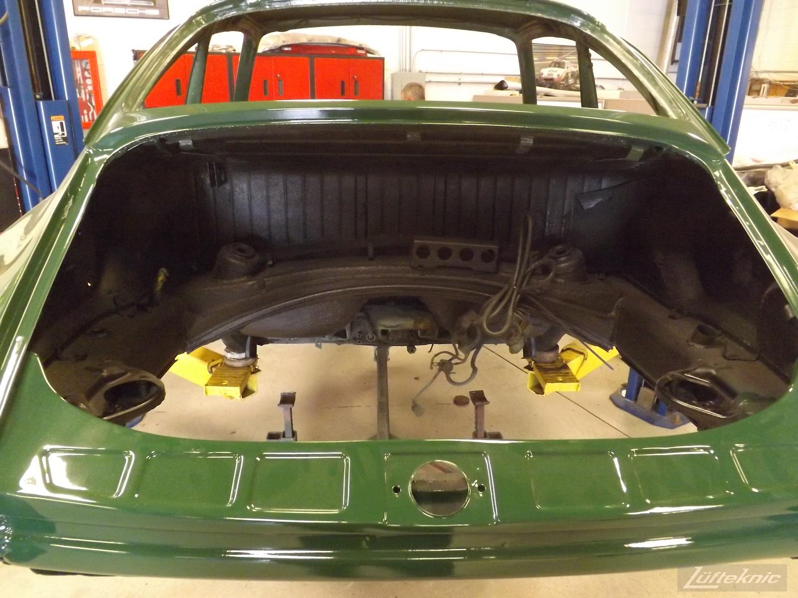Empty engine bay of an Irish Green Porsche 912 undergoing restoration at Lufteknic.