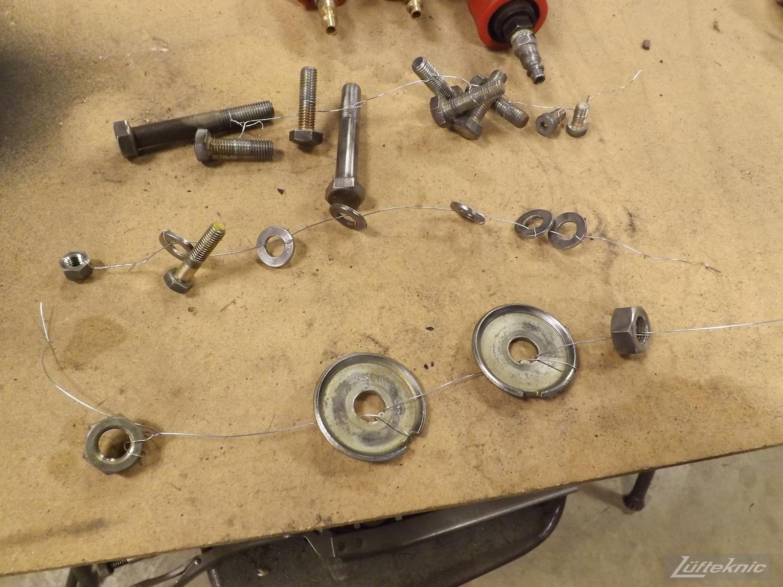 Hardware being prepped for refinishing for an Irish Green Porsche 912 undergoing restoration at Lufteknic.