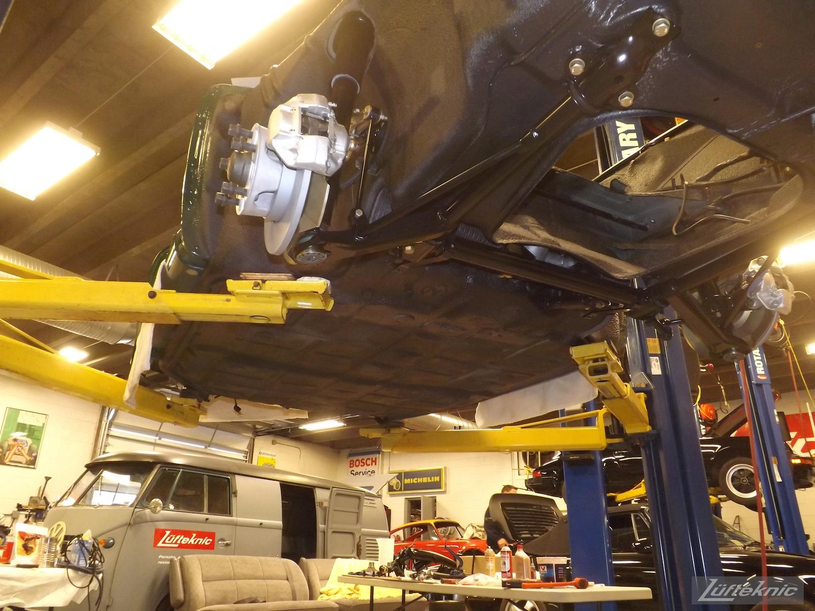 Fresh suspension and brakes on an Irish Green Porsche 912 undergoing restoration at Lufteknic.