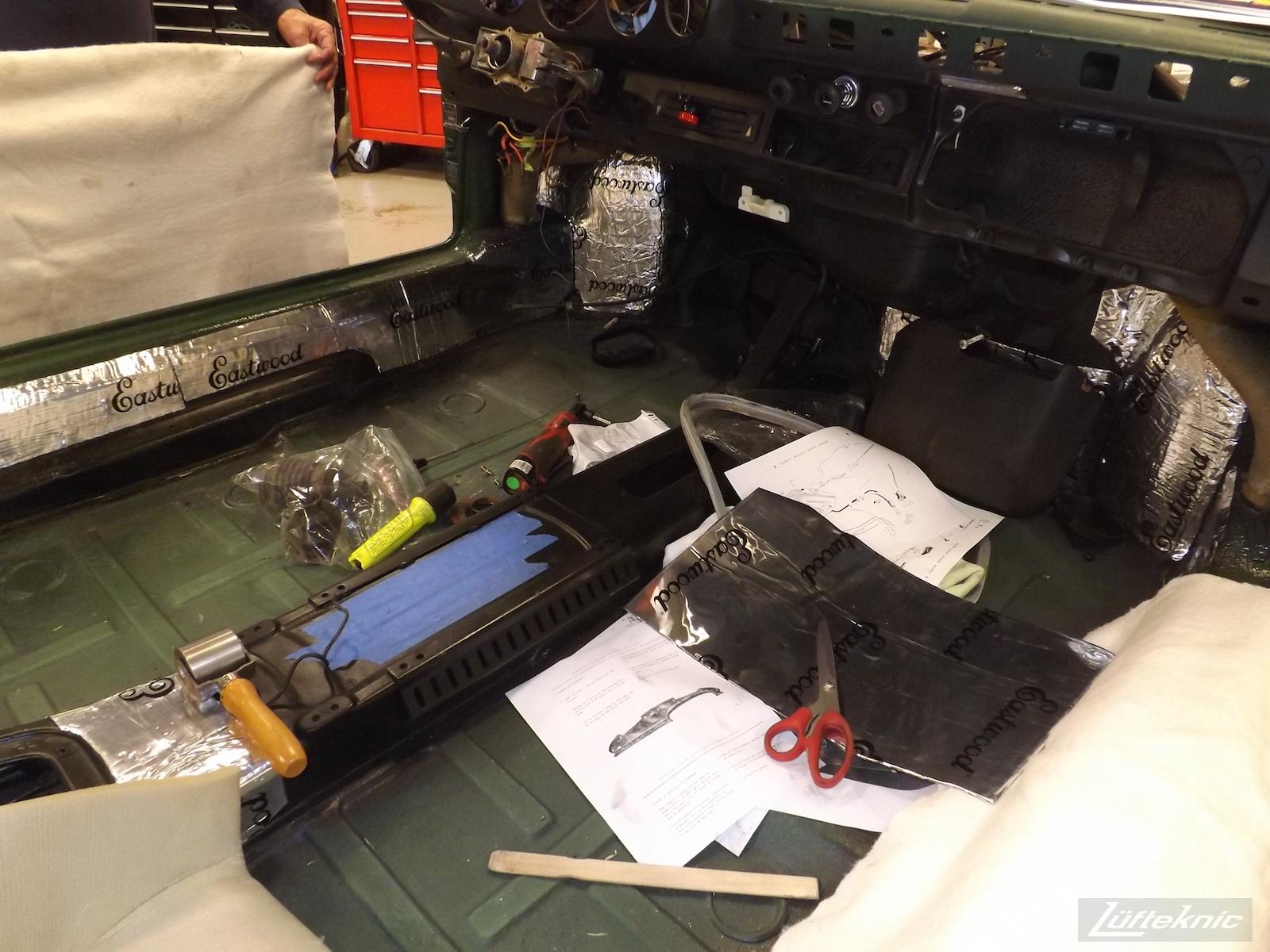Installing Eastwood sound deadening panels on an Irish Green Porsche 912 undergoing restoration at Lufteknic.