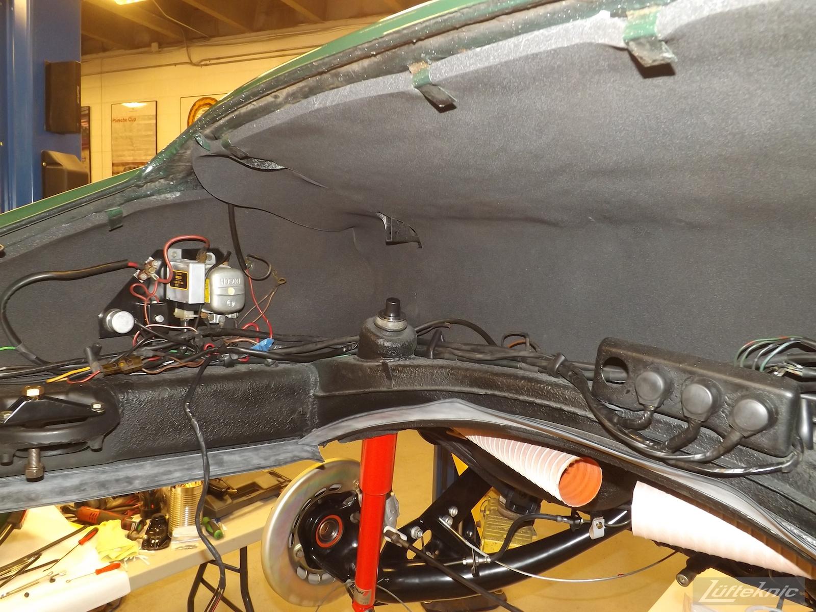 Engine bay reassembly on an Irish Green Porsche 912 undergoing restoration at Lufteknic.