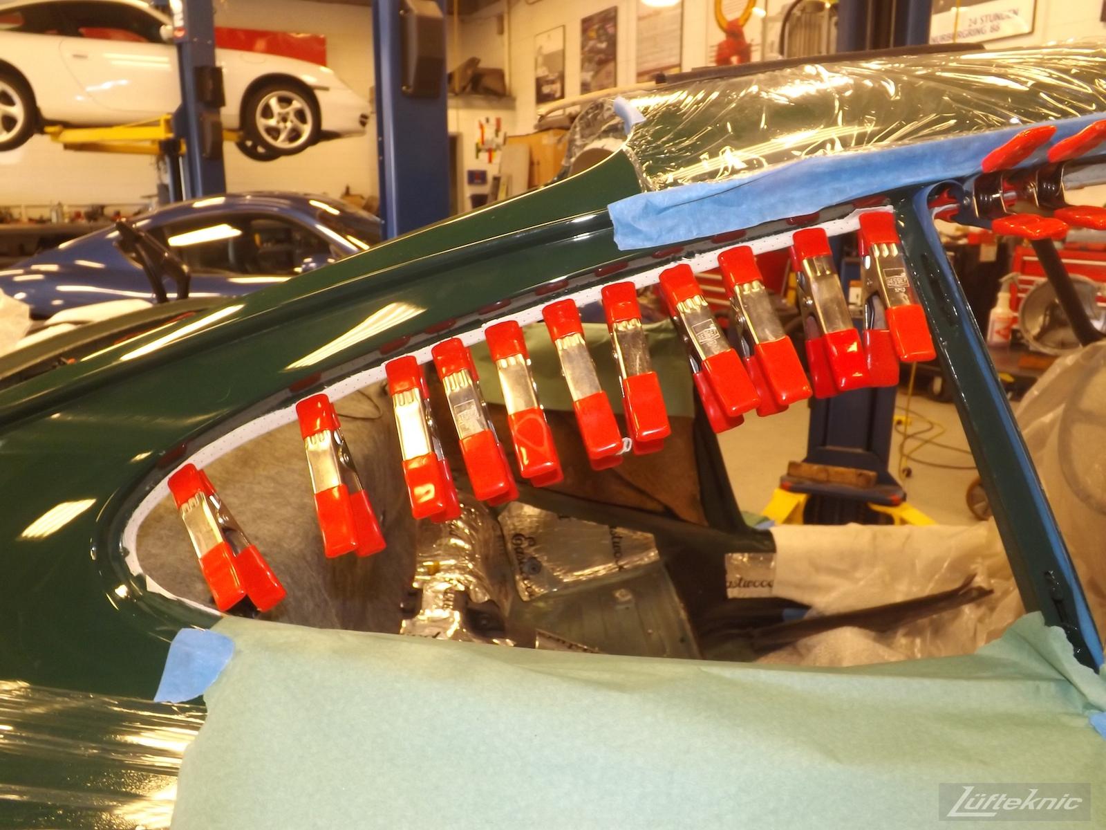 Headliner installation on an Irish Green Porsche 912 undergoing restoration at Lufteknic.
