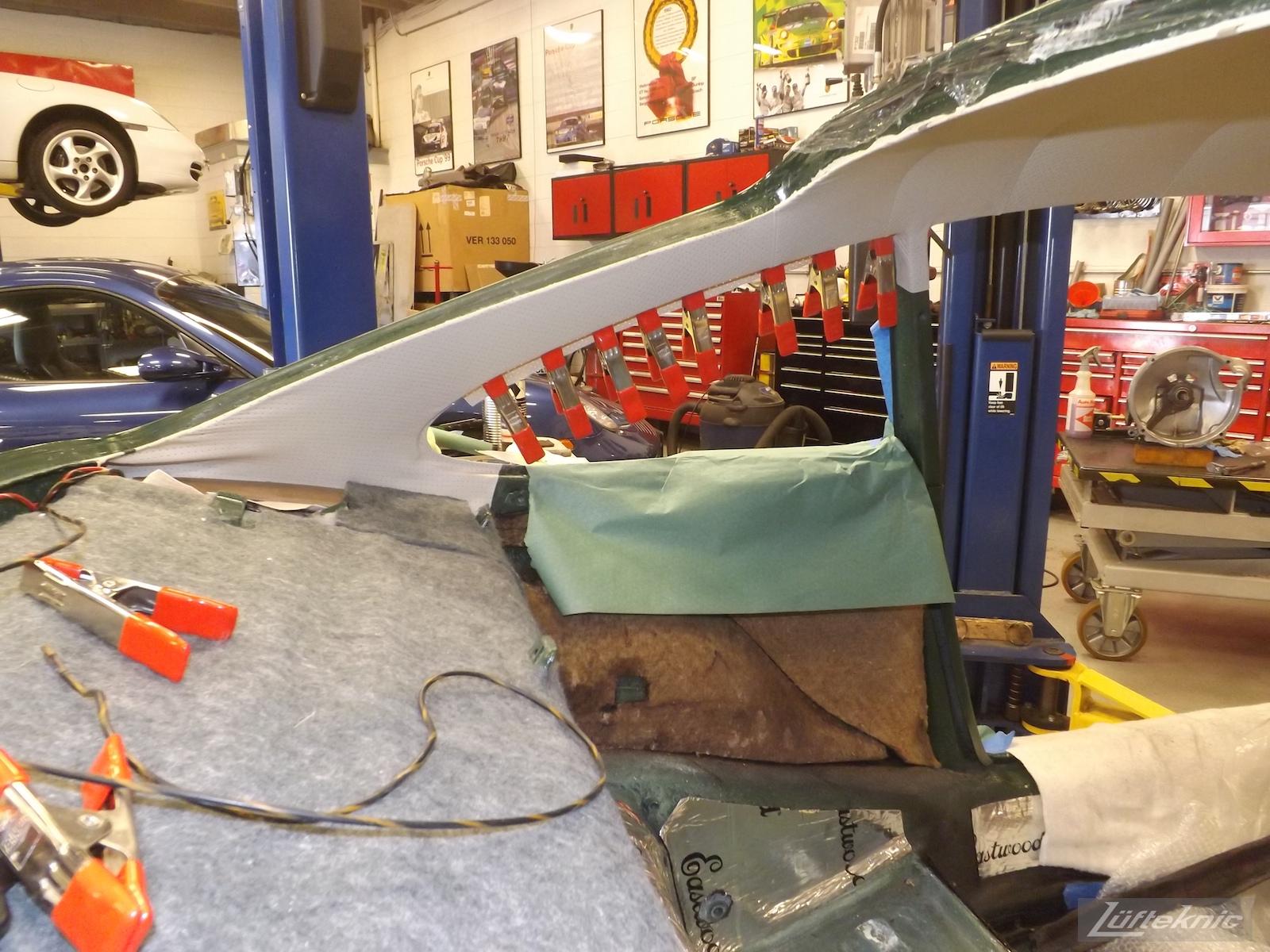 Headliner and interior installation on an Irish Green Porsche 912 undergoing restoration at Lufteknic.