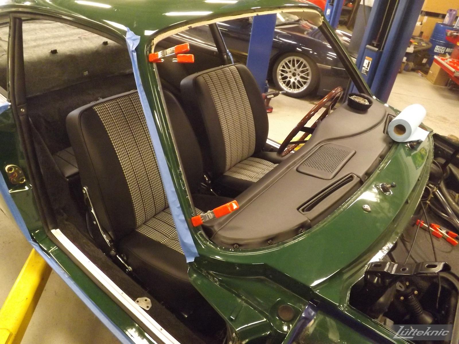 Finishing the interior reassembly of an Irish Green Porsche 912 undergoing restoration at Lufteknic.
