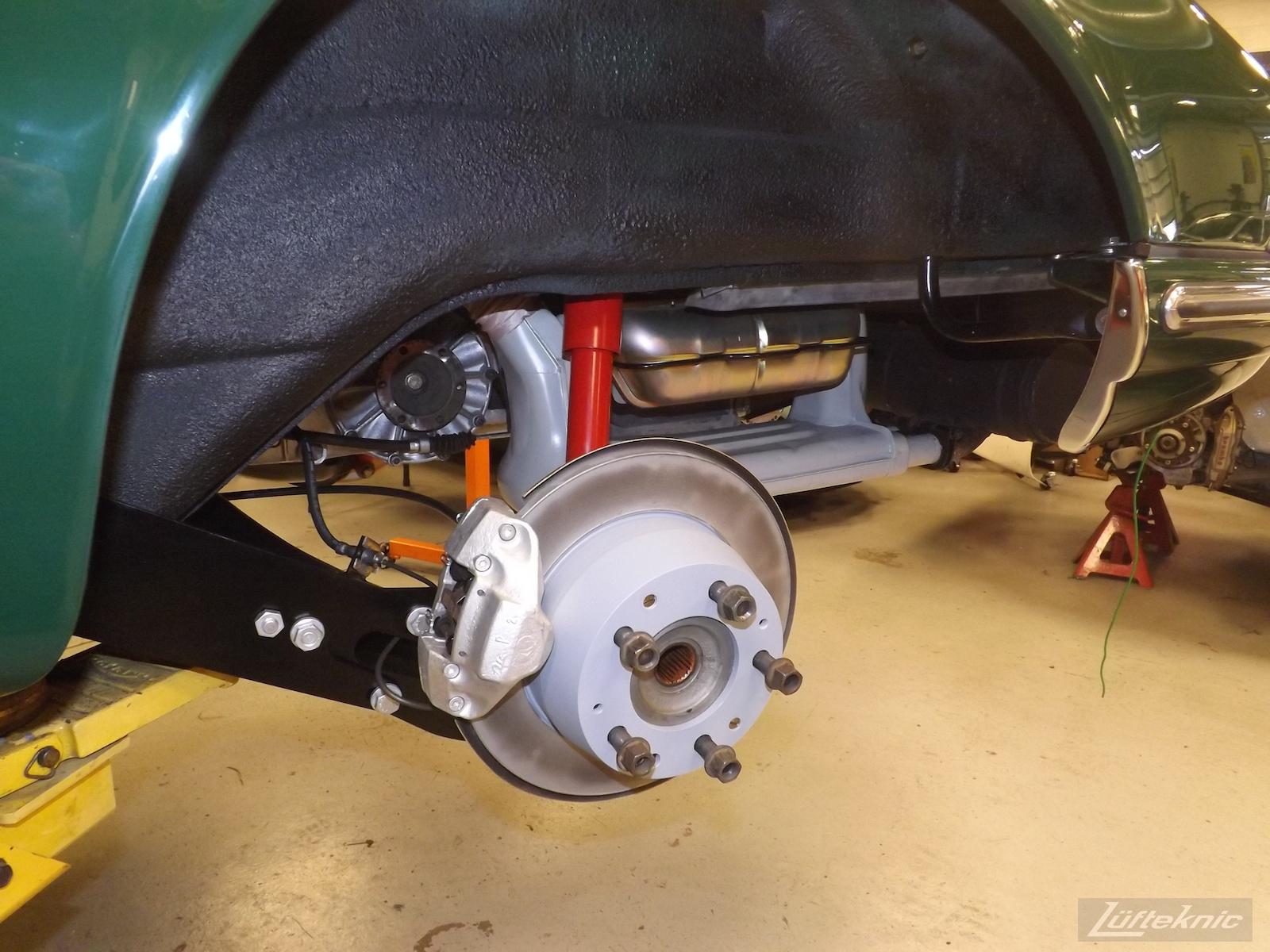 Finished brakes on an Irish Green Porsche 912 undergoing restoration at Lufteknic.